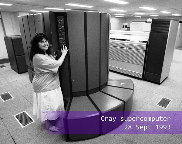 a woman standing next to the Cray supercomputer in 1993