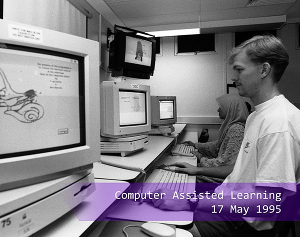 a student testing out the computer assisted learning in 1995