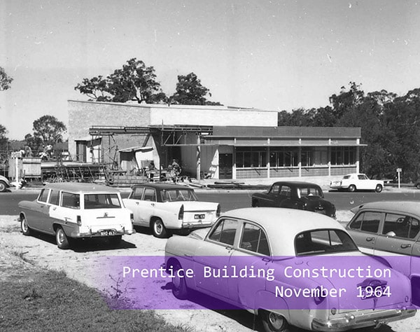Cars parked outside of the Prentice Centre construction site in 1964