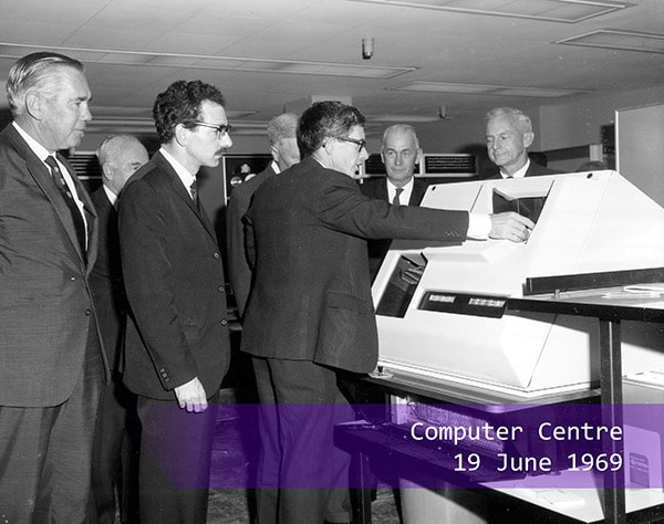 A group of men using the computer in 1969